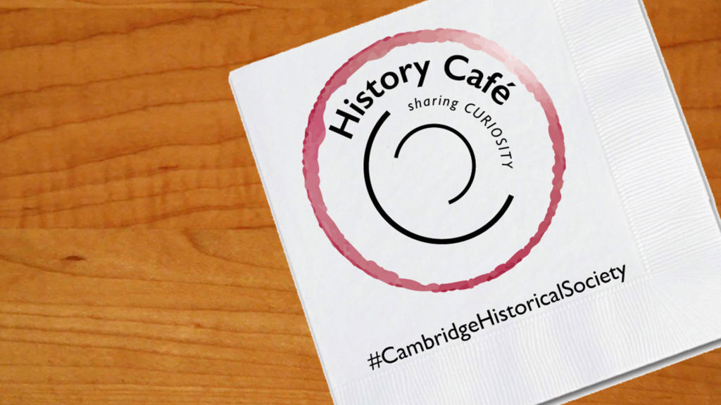"""Napkin on table with words """"History Cafe"""""""